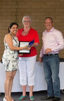 Westcare Support Services Manager Sherry Kaur receives her award from President